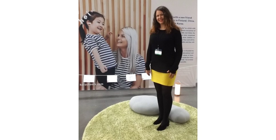 Milla Kokko shows off HEI School's display at the Second Nordic Innovation Summit in Seattle